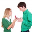 Woman giving ring to man — Stock Photo