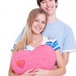Young couple with pink heart — Stock Photo