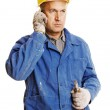 Senior worker talking on the mobile phone — Stock Photo