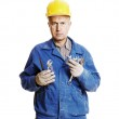 Serious worker with different tools — Stock Photo