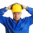 Serious workman looking at camera - Stock Photo