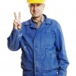 Smiley workman showing victory sign — Stock Photo