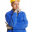 Thoughtful workman with tools — Stock Photo #5159382