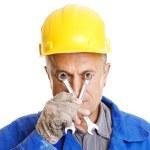 Workman looking through screw keys — Stock Photo