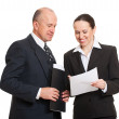 Director and secretary looking at documentation — Stock Photo