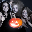 Three angry ghost with orange pumpkin — Stock Photo #5159445
