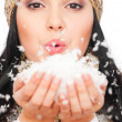 Beautiful woman with snow in her palm — Stock Photo
