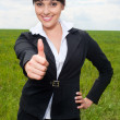 Businesswoman showing thumbs up — Stock Photo