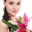 Lovely woman with bunch of flowers — Stock Photo