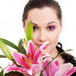 Lovely woman with bunch of purple flowers — Stockfoto