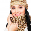 Stock Photo: Smiley young woman in hat and scarf