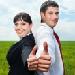Businesspeople showing thumbs up - Stock Photo