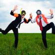 Cheerful businesspeople dancing on the field — Stock Photo