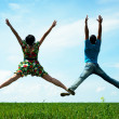 Stock Photo: Happy couple jumping