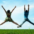 Happy couple jumping — Stock Photo #5159823