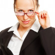 Alluring woman holding her glasses - Stock Photo