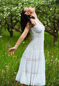 Carefree young woman in park — Stock Photo