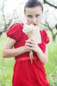 Woman in red dress with posy — Stock Photo
