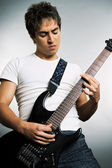 Young man playing on the guitar — Stock Photo