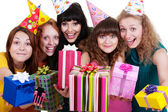 Happy girls with gift boxes — Stock Photo