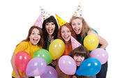 Happy girls with variegated balloons — Stock Photo