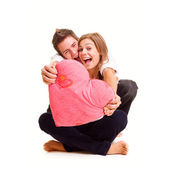 Cheerful couple with heart — Stock Photo