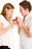 Young man giving his girlfriend ring — Photo
