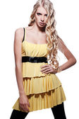 Alluring blonde in yellow dress — Stock Photo