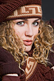 Attractive woman in brown scarf and cap — Stock Photo
