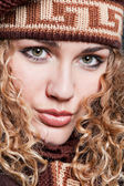 Portrait of beautiful blond in knitted cap — Stock Photo