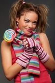 Attractive young woman with candy — Stock Photo