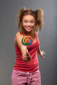 Funny girl with lollipop — Stock Photo