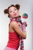 Funny girl with motley candy — Stock Photo