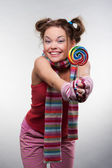 Funny girl with sugarplum — Stock Photo