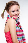 Pretty smiley girl in striped scarf — Stock Photo
