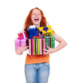 Happy young woman with gift boxes — Stock Photo