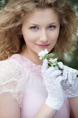 Beautiful young woman in white gloves — Stock Photo