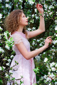 Lovely woman in flowers — Stock Photo