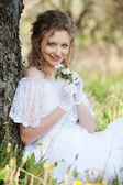 Pretty woman with flower in park — Stock Photo