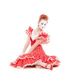 Beautiful mime in red dress sitting on the floor — Stock Photo