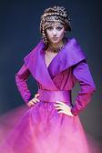 Glamour model in purple dress — Stock Photo