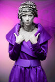 Glamour woman in violet dress — Stock Photo