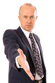 Businessman greeting you — Stock Photo