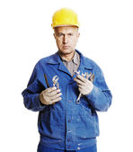 Serious worker with different tools — Foto Stock