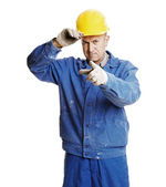 Smiley workman pointing — Stock Photo