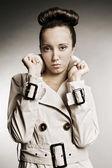 Attractive woman in grey cloak — Stock Photo