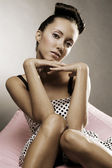 Pretty woman sitting on the chair — Stock Photo