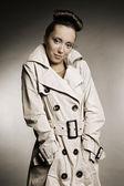 Woman in grey cloak — Stock Photo