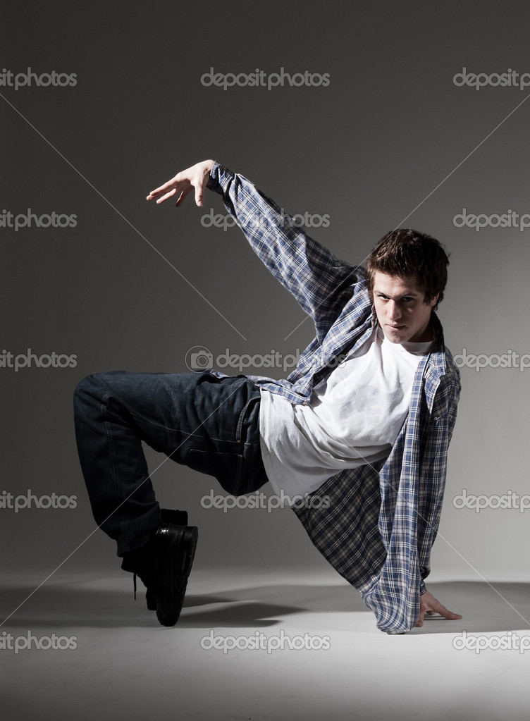 Breakdancer showing his skill against grey background — Stock Photo #5156972