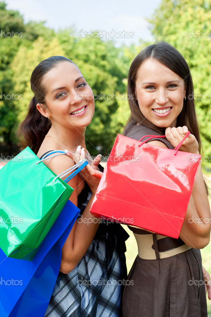 Two pretty friends with bags — Stock Photo #5157081